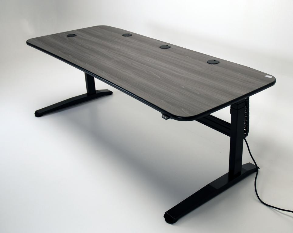 ... Height Adjustable Music Studio Desk Shown In Iconic Maple